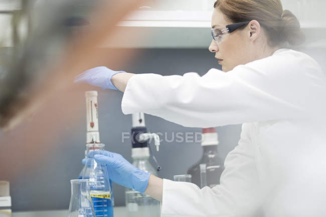Female Scientist working with liquid in lab — Stock Photo