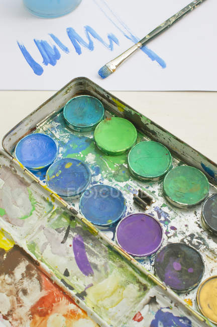 Watercolours with paintbrush, close up — Stock Photo