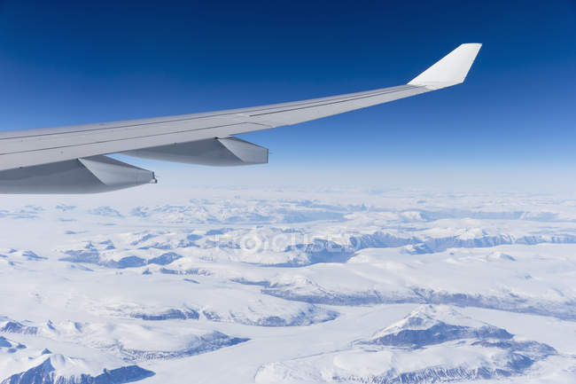Aeroplane flying over Greenland ice sheet — Stock Photo