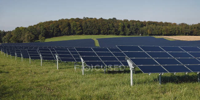 View of modern solar panels on grass against sky, Bavaria, Germany — Stock Photo