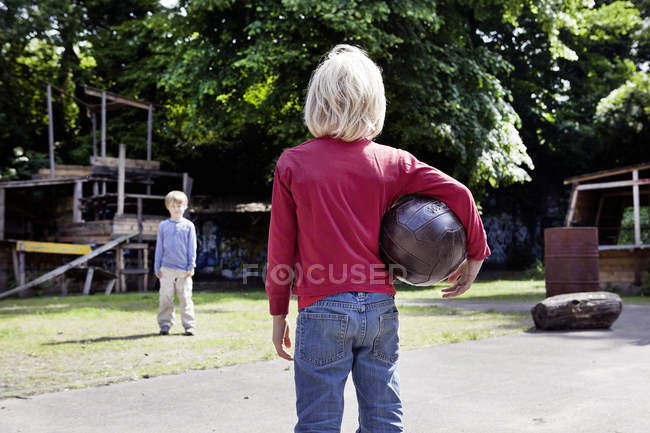 Boys playing with ball in playground — Stock Photo