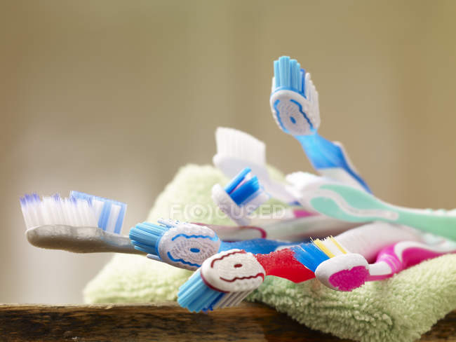 Toothbrushes on towel on blurred background — Stock Photo