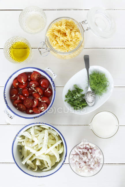 Varieties of ingredients on wooden table, close up — Stock Photo