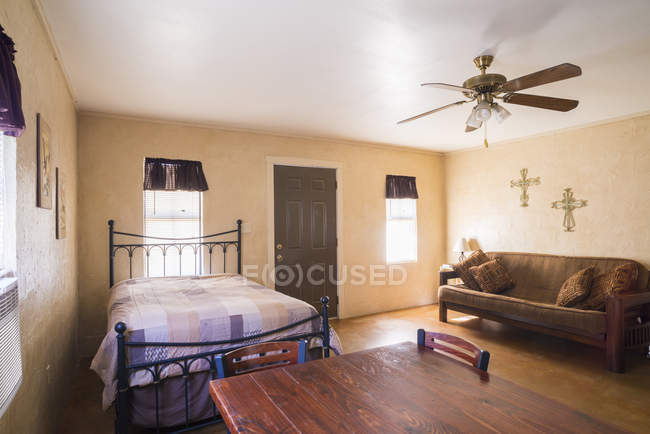 Living quarters interior with bed, sofa and dining table — Stock Photo