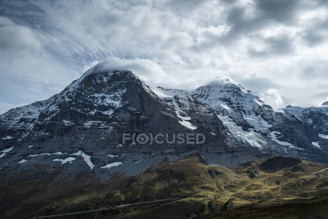 Switzerland, Berner Oberland, Eiger and Moench, right Jungfraujoch and weather station under clouds — Stock Photo