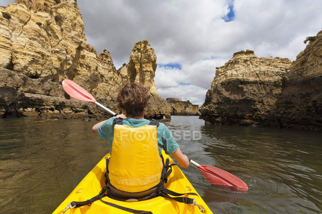 Portugal, Lagos, Teenage boy rowing Kayak — Stock Photo