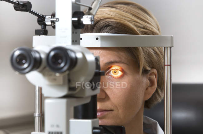 Eye examination at slit lamp with female patient, closeup — Stock Photo