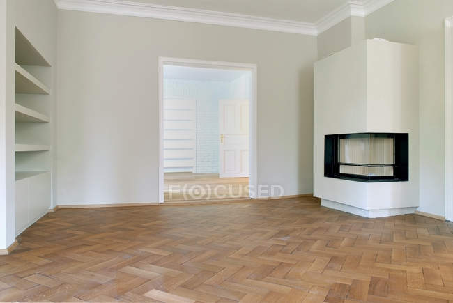 Modern interior of empty room with fireplace — Stock Photo
