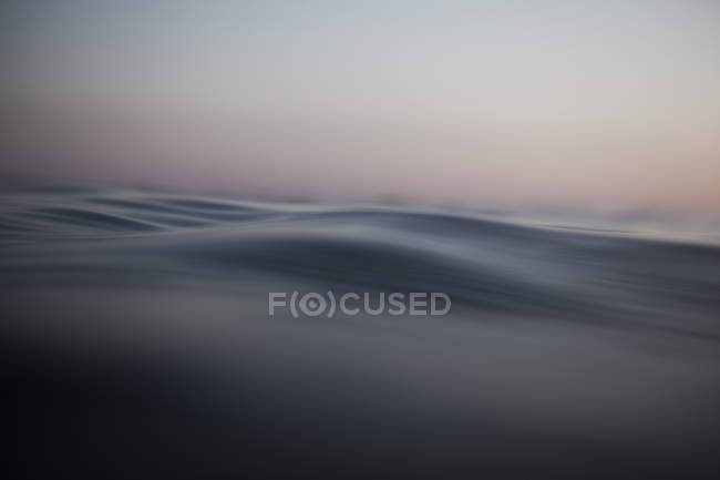 Sea wave closeup view at calm sunset — Stock Photo