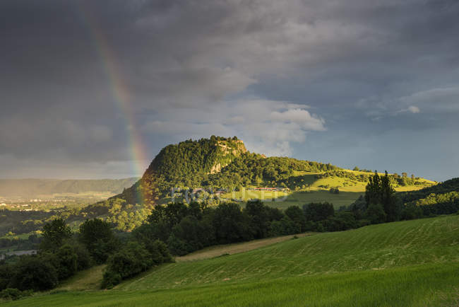 Germany, Baden Wuerttemberg, Constance, View of Hegau green mountain landscape with rainbow — Stock Photo