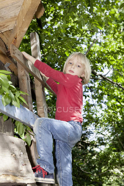 Boy climbing on steps in playground — Stock Photo