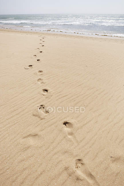 Spain, Footsteps on sand at beach — Stock Photo