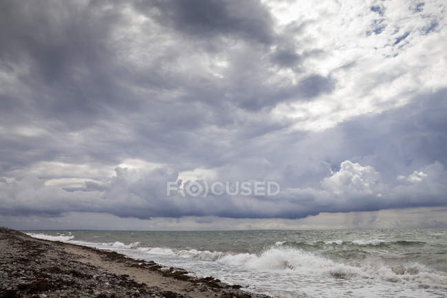 Germany, Schleswig-Holstein, Fehmarn, Flgge, coast and clouds during daytime — Stock Photo