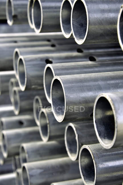 Germany, Bavaria, Metal tubes stacked — Stock Photo