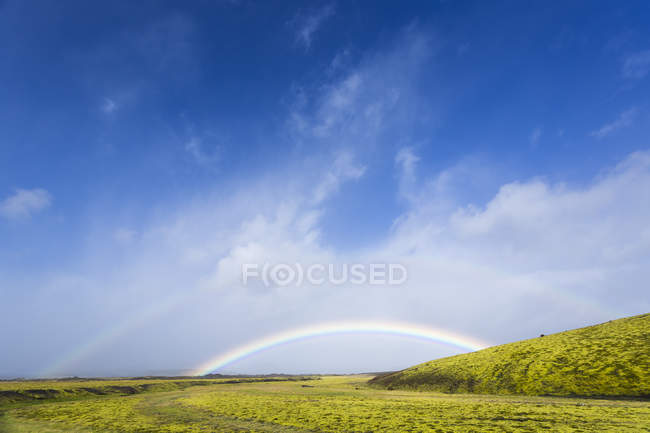 Iceland, Kirkjubaerklaustur, Rainbow in highlands during daytime — Stock Photo