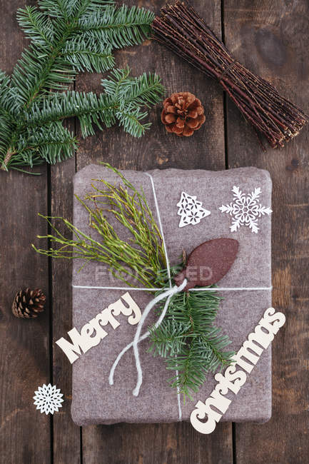 Christmas gift on wooden table — Stock Photo