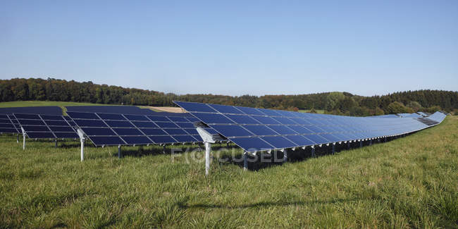 Germany, Bavaria, Solar panels on grass against sky — Stock Photo