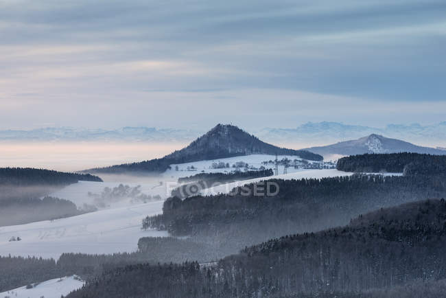 Germany, Baden Wuerttemberg, Constance, Volcanic cone in snow — Stock Photo