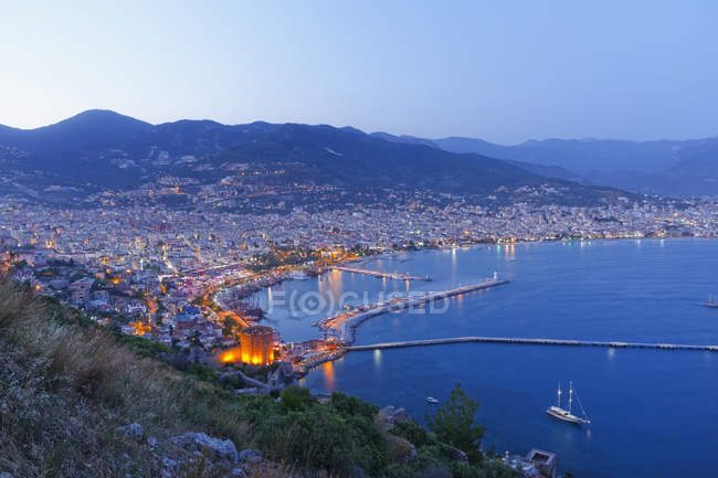 Turkey, Alanya, View of Red tower with harbour at dawn — Stock Photo