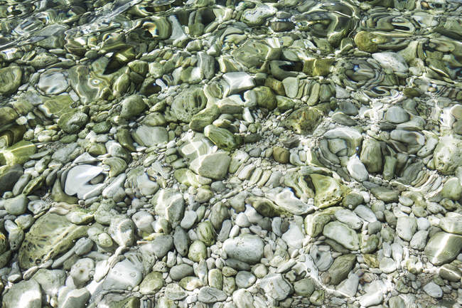 Croatia, Mediterranean Sea, ocean, pebbles at the ground — Stock Photo