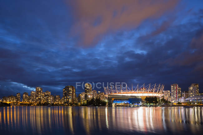 Canada, Illuminated skyline of Vancouver at night with BC Place Stadium and Plaza of Nations — Stock Photo