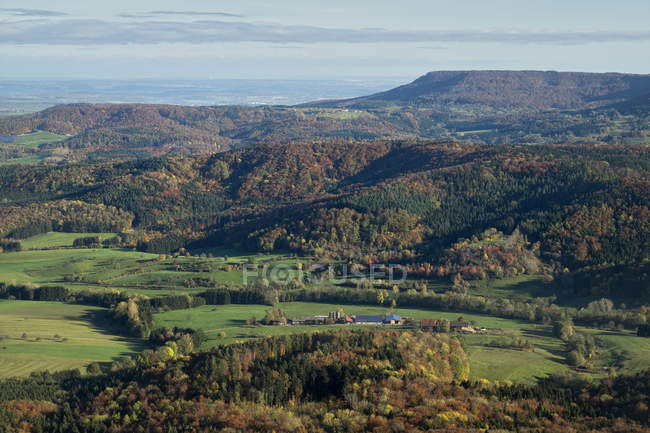 Germany, Baden Wuerttemberg, forest in autumn and mountains — Stock Photo
