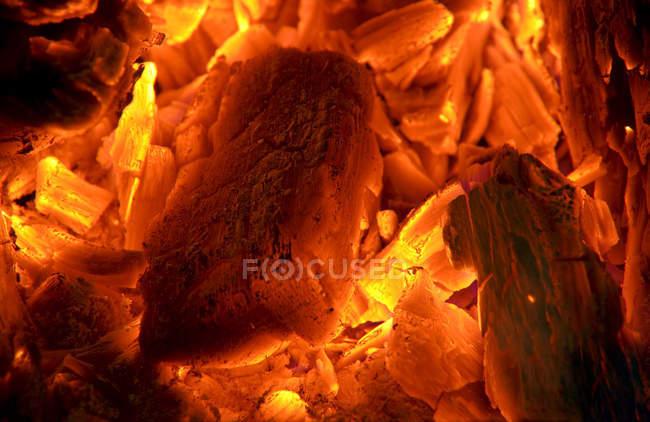 Closeup view of glowing charcoals heap — Stock Photo