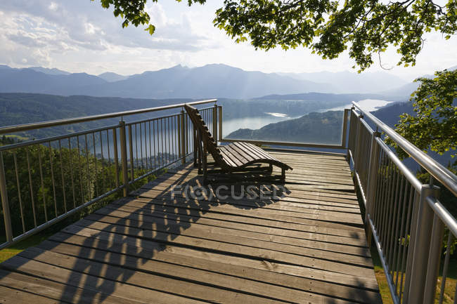 Austria, Carinthia, Gschriet, observation point with wooden bench from balcony to Millstaetter See — Stock Photo