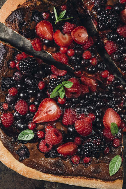 Pizza with berries with nutella and minz — Stock Photo