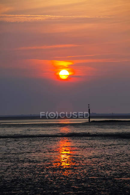 Germany, View of low tide at north sea during sunset — Stock Photo