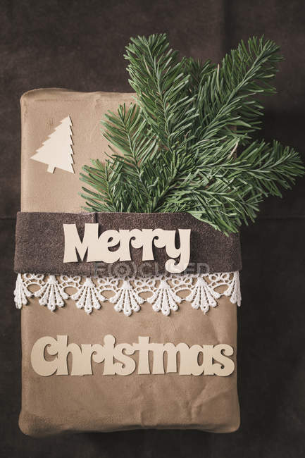Top view of Christmas gift on rustic leather — Stock Photo