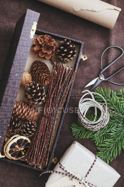Utensils for wrapping Christmas presents on rustic leather — Stock Photo