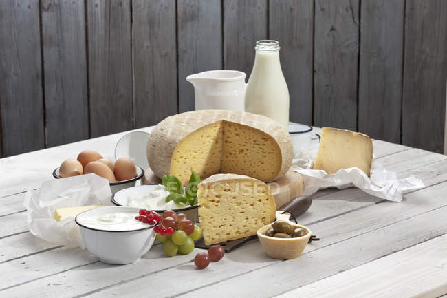 Dairy products placed on wooden table — Stock Photo