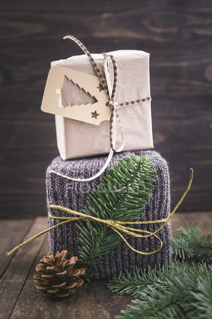 Christmas gift wrapped in knitted gift wrap — Stock Photo