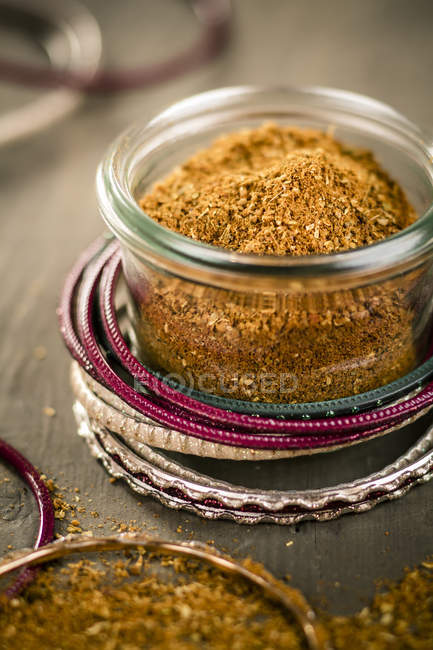 Indian bangles with jar of garam masala, close up — Stock Photo