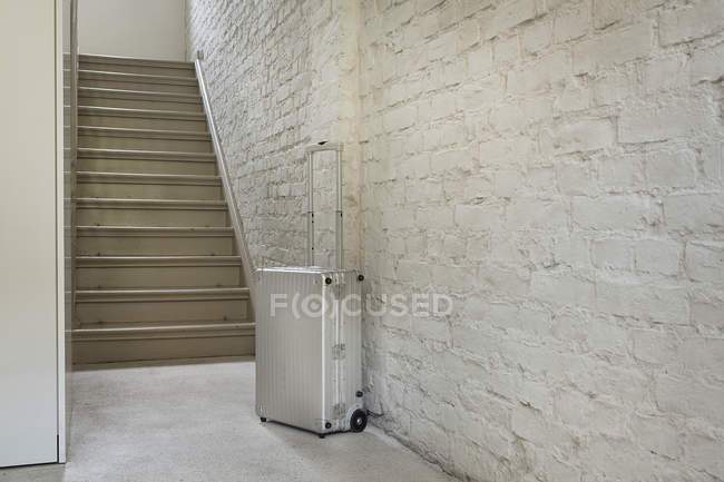 Luggage near staircase indoors — Stock Photo