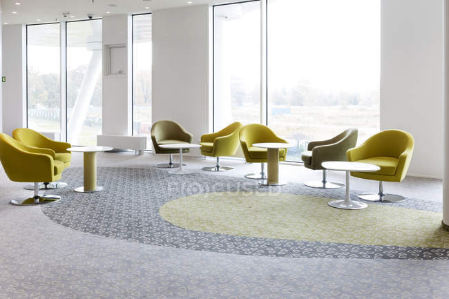 Green seating furniture at lounge of hotel — Stock Photo