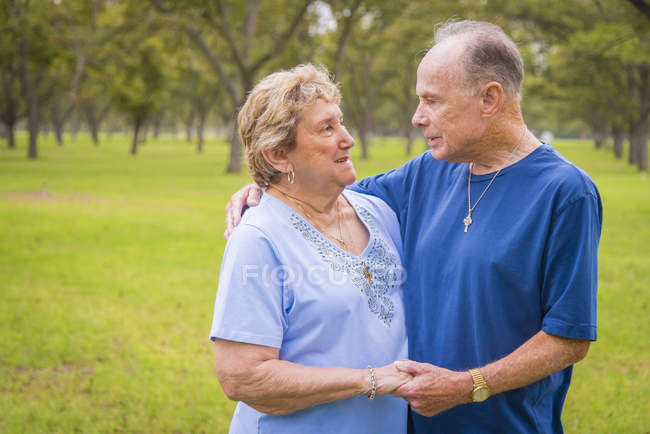 Portrait of senior couple looking at ech other outdors — Stock Photo