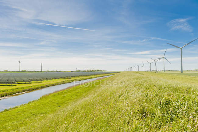Germany, Schleswig-Holstein, View of wind turbine in fields — Stock Photo