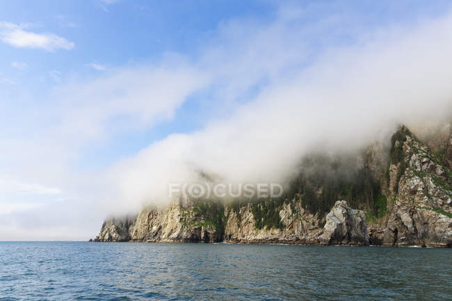 USA, Alaska, Seward, Resurrection Bay, rock hidden behind a cloud — Stock Photo