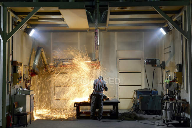 Welder wearing protective workwear working in a factory — Stock Photo
