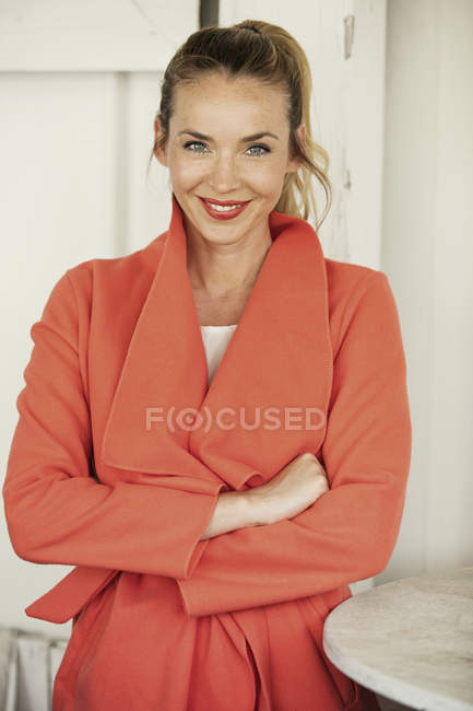 Portrait of smiling blond woman wearing fashionable jacket — Stock Photo