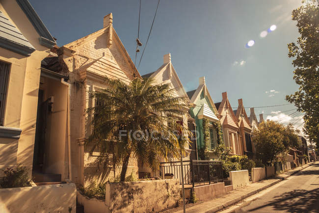 Australia, New South Wales, Sydney, Newtown, row of old residential houses at sunlight — Stock Photo