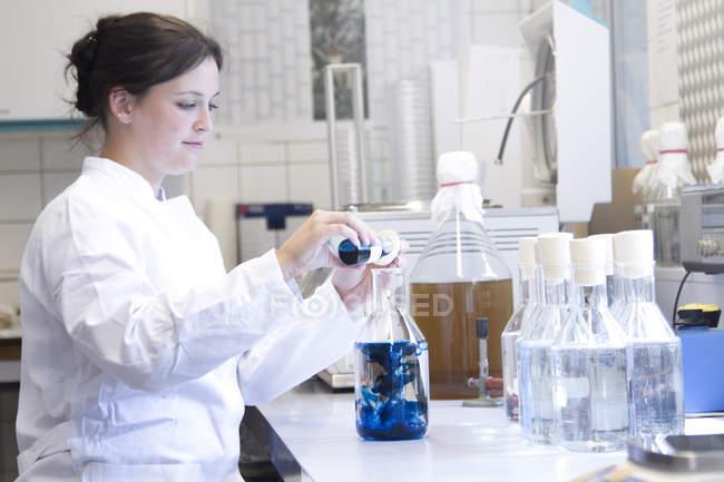 Female food analyst working in laboratory — Stock Photo | #181901938