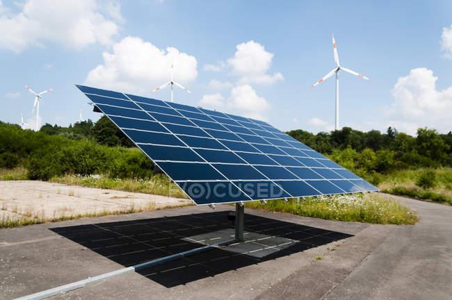 Germany, Rhineland Palantine, Morbach, Solar panel and wind turbines — Stock Photo
