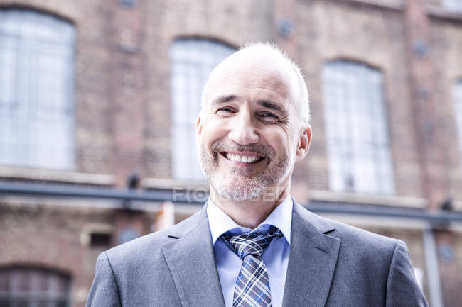 Businessman smiling  portrait — Stock Photo