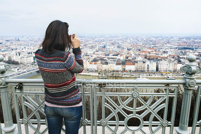 Hungary, Budapest, woman taking a picture from Gellert Hill — Stock Photo