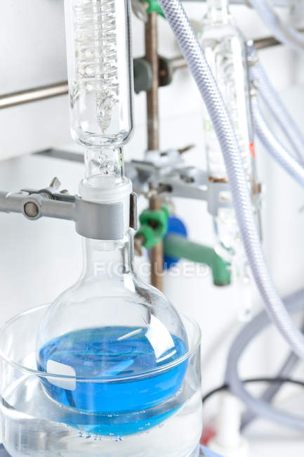 Blue liquid in flask at chemical laboratory — Stock Photo
