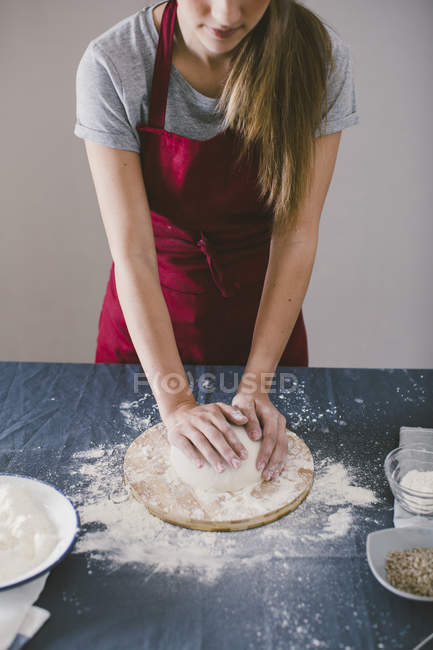 Woman kneading dough for preparing homemade bread — Stock Photo