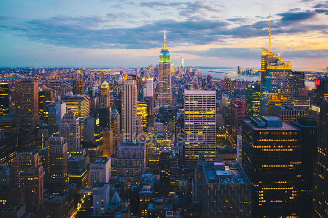 Scenic view of Manhattan illuminated in evening, seen from above, New York City, USA — Stock Photo